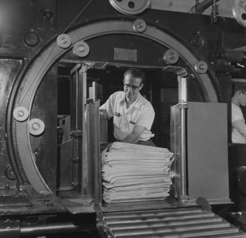 May 27, 1957: An employee at The Pittsburgh Press bundles newspaper for loading onto delivery trucks.