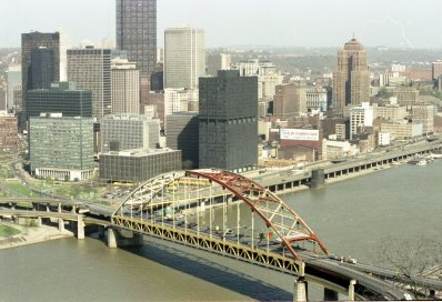 The Fort Pitt Bridge in the process of being repainted against the backdrop of the city's skyline in 1981. (Post-Gazette photo)