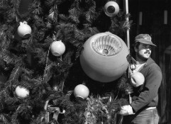 It's hard to realize just how big those ornaments are when they are towering 100 feet or so above your head. In 1991, Phil Reiss of Sargent Electric Company worked to move a section of the tree into position. (Al Fuchs/The Pittsburgh Press)