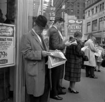 Commuters read news of President John F. Kennedy's assassination on Nov. 22, 1963. (Morris Berman/Post-Gazette)