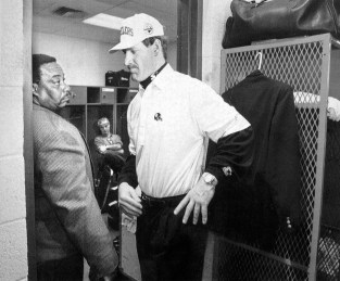 Coach Bill Cowher pauses in the locker room after the Steelers lost Super Bowl XXX, 27-17, to the Cowboys. (Bill Wade/Post-Gazette)