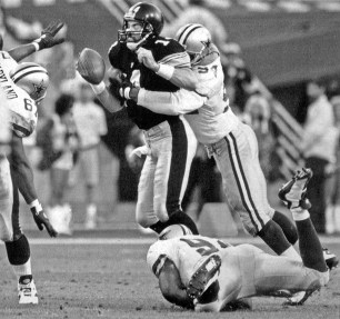 Steelers quarterback Neil O'Donnell is sacked by Dallas defensive end Charles Haley in Super Bowl XXX. (Robin Rombach/Post-Gazette)