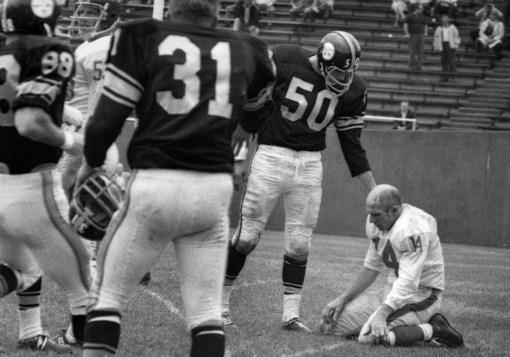 The first frame shows Steeler linebacker Bill Saul with his hand on Tittle's shoulder. (Morris Berman/Post-Gazette)