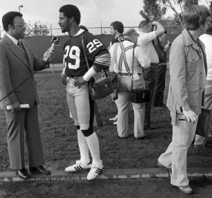 Defensive back Ron Johnson answers questions. Johnson played seven seasons in the NFL, all with the Steelers. (Albert M. Herrmann Jr./The Pittsburgh Press)