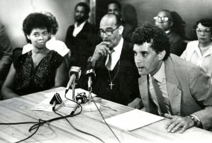 Valarie Redmond, coordinator of B-PEP directors, and Rev. Charles W. Buckner, listen to Tim Stevens, project founder (July 1986, Bill Levis/Post-Gazette)