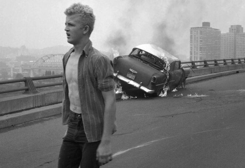 Bill Luete, 16, walks away from the burning vehicle. (Morris Berman/Post-Gazette)