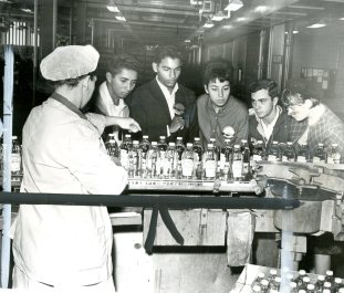 Sour smell of success is experienced at the vinegar bottling lines at the H.J. Heinz Plant by Amigos from left, Andres Gonzales, Aquiles Machuca and Ignacio Gonzalez, with Jeannette Owens of Ben Avon. The two people on the right were not identified on the photo.