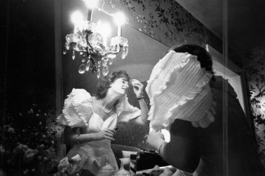 Coulson Duerksen puts finishing touches on makeup before the 1981 ball.