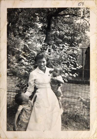 Rachel Poole as a nurse with daughters Tenache and Adriene. (Courtesy of Rachel Poole)
