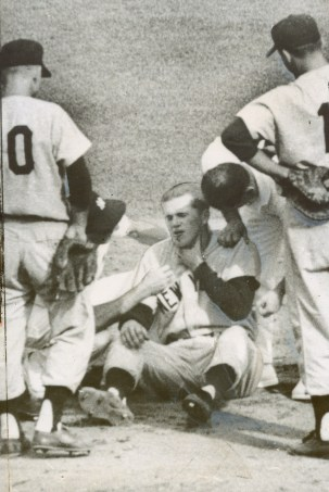 Tony Kubek clutches his throat after being hit by Bill Virdon's grounder.
