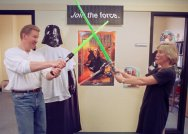 "Matt Rogers, left, and Valerie Micher joust with toy lightsabers they have in their ""Star Wars"" display at their offices at ServiceWare, Inc. in Oakmont, Pa., Friday, May 7, 1999. (AP Photo/Keith Srakocic)"