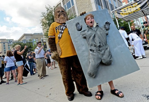 Tim Vetterly, of Avalon, dressed as Chewbacca, stands next to Owen Chaffin, 10, of Bethel Park, dressed as Hans Solo frozen in carbonite. The two took part in Star Wars day Wednesday at PNC Park.