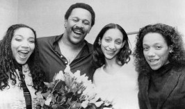 "In 1980, Willie Stargell meets the disco group Sister Sledge, who are the performers of the Pirates' theme song, ""We Are Family."" (Associated Press)"