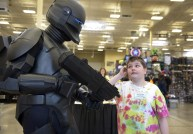 """Mark Hoag of Ambridge, dressed as a a Republic commando from """"Star Wars,"""" greets Hunter Bolyard, 11, of Morgantown, W.Va., during Steel City Con Friday at the Monroeville Convention Center on April 5, 2013. (Julia Rendleman/Post-Gazette)"""