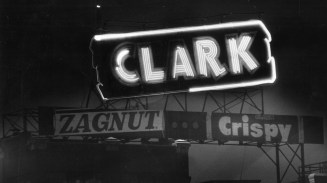 The Clark Candy sign glows atop the D.L. Clark Co. building on Pittsburgh's North Side. Picture taken April 3, 1986. (Pittsburgh Press)