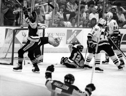 Mario Lemieux scores a goal in game six of the Stanley Cup playoffs against the Minnesota North Stars in 1991. (Darrell Sapp/Post- Gazette)