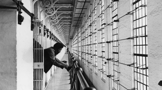 An unnamed inmate at Western Penitentiary ties his shoes to begin the morning. Photo published Nov. 5, 1978. (Pittsburgh Press)