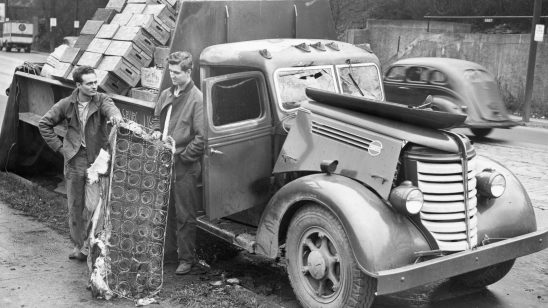 James Alucci and his brother-in-law Stanley Nasiatka of Waynesburg examine the cargo from their destroyed truck. Photo published Nov. 25, 1946. (Pittsburgh Press)