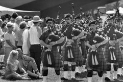 McDonald Pipe Band marches to the stage at Point State Park. Photo published July 5, 1986. (Post-Gazette)