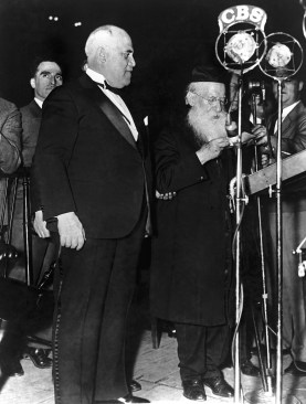 Mayor John P. O'Brien of New York City, left, listens to Rabbi Moses Sebulun Margolies. President of the Congregation of the American Orthodox Jews, as he addresses the audience at Madison Square Garden on May 4, 1933. (Associated Press)