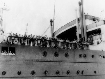 This is a 1939 photo of German Jewish refugees aboard the German liner St. Louis. The location and specific date are unidentified. (Associated Press)