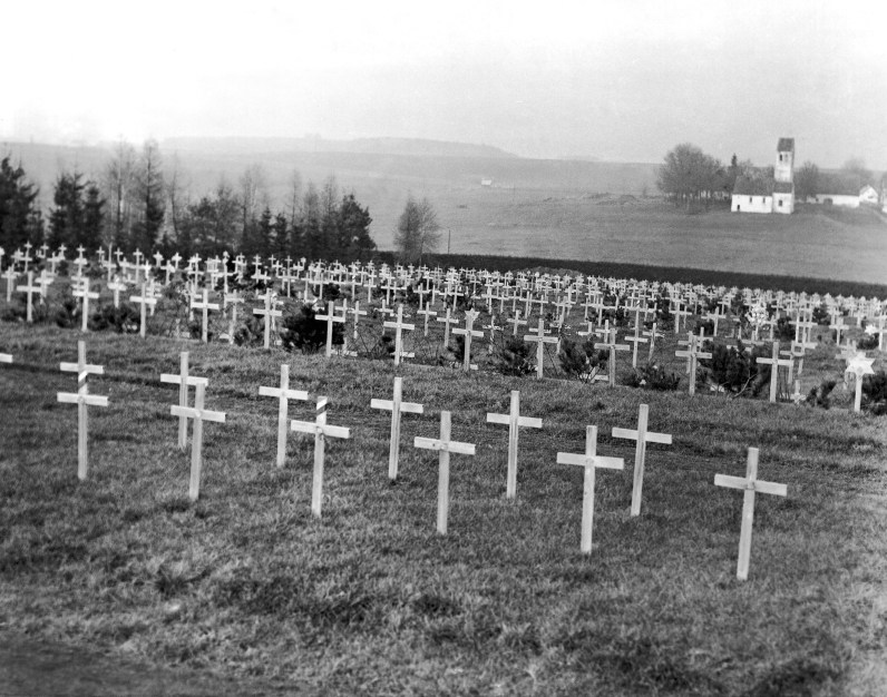 Rows of white wooden crosses mark the graves of some of the victims of the former concentration camp just outside Dachau on Dec. 23, 1948. (Associated Press)