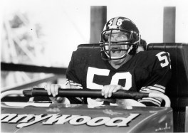 The Lambert Loop? Steelers linebacker Jack Lambert gets ready to ride the Laser Loop while filming a commercial for the park.
