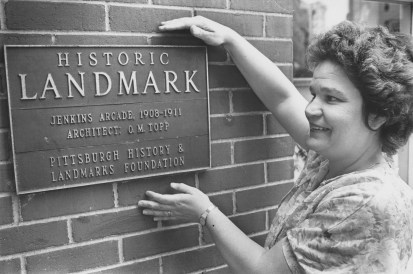 Audrey Munhall with the arcade's historic landmark designation on April 16, 1981. (John Heller/Post-Gazette)