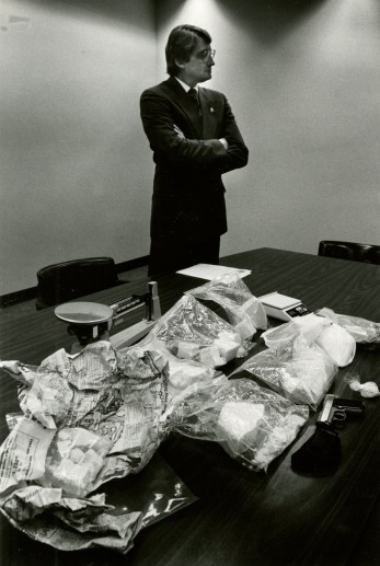 DEA Agent Ernie Batista with evidence from a 1994 raid in Donora. (Peter Diana/Pittsburgh Post-Gazette)
