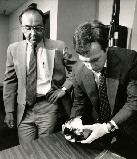 "Lynn Wietharn with Pittsburgh Postal Inspector Joseph McGowan holding a 4-lb. ""rock"" of crack cocaine in 1990."