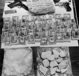 Two pistols, 2.2 pounds of cocaine, and a whole lot of cash seized by county police in 1986. (Harry Coughanour/Pittsburgh Post-Gazette)