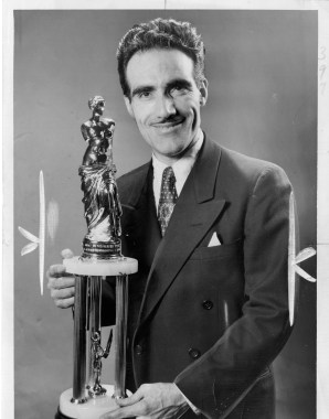 Franco Insana shows off the Masters' trophy he won at the National Hair Guild Society Competition in 1954.