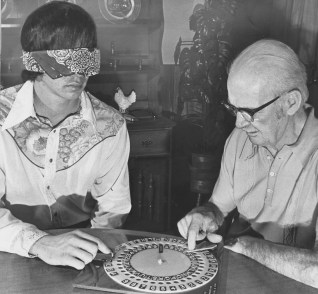 John Marker, left, and inventor L.A. Donaldson practice on a Dial-A-Con, Dec. 18, 1975. https://archives.post-gazette.com/image/147287618/?terms=John%2BMarker%2BL.A.%2BDonaldson