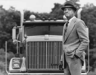 Charles Wright, 72, of Penn Hills has invented the Wright Gravity Emergency Stop, a patented device to stop runaway trucks. He and his father started working on the device in the early 60s, but his father died in 1966, which slowed the progress. Here, he stands in front of a truck in Leetsdale Industrial Park, June 21, 1989. (Susie Post/Pittsburgh Press)