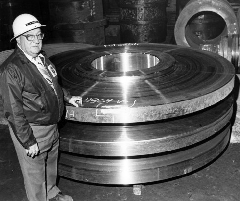 Wayne Martin, senior designer at U.S. Steel's Homestead Works, stands next to his power generating turbine disk, one of six patents he had when this photo was taken in November 1982. (Albert M. Herrmann Jr./Pittsburgh Press) https://archives.post-gazette.com/image/142964379/?terms=%22wayne%2Bmartin%22%2Bus%2Bsteel