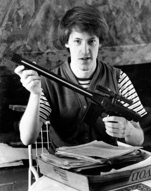 Todd Burton displays the toy gun he invented and piles of paperwork involved in the patent he's applying for, March 15, 1985. (Donald J. Statzer/Pittsburgh Press)