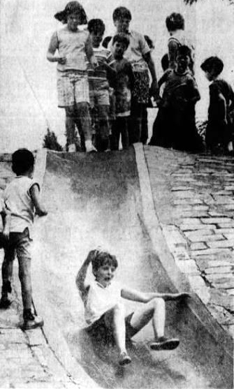 """July 14, 1968: The caption for this photo calls the slide a """"specially waxed concrete slide in a park on Beechwood Boulevard."""" (Post-Gazette)"""