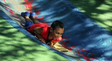 Blake DeJulio, 5, of Hazelwood tests the blue slide, July 25, 2013. (John Heller/Post-Gazette)