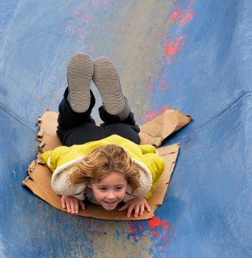 Sidnie Ledbetter, 6, of Chester Springs takes a trip down the blue slide, Nov. 30, 2014. (Larry Roberts/Post-Gazette)