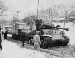 Yes, that's a Sherman tank freeing a truck from the snow. (Post-Gazette)
