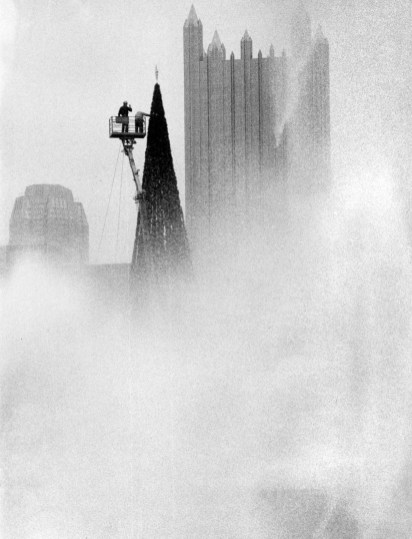 The Christmas tree in Point State Park, built by Duquesne Light for the second year, rises out of fog, Nov. 9, 1989. (Thomas Ondrey/Pittsburgh Press)