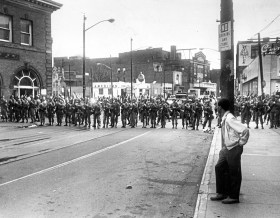National Guardsmen move up Centre Avenue at Devilliers Street in Pittsburgh's Hill District in the midst of riots on the afternoon of Sunday, April 7, 1968. The Hill erupted in the days after the assassination of the Rev. Martin Luther King Jr. (Al Herrmann, Jr./The Pittsburgh Press)