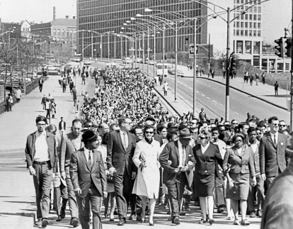 Marchers make their way down Centre Avenue on their way to Point State Park for a memorial service, Sunday, April 7, 1968, less than three days after the assassination of the Rev. Martin Luther King Jr. During the march, riots continued in the city's Hill District. (Donald J. Stetzer/The Pittsburgh Press)