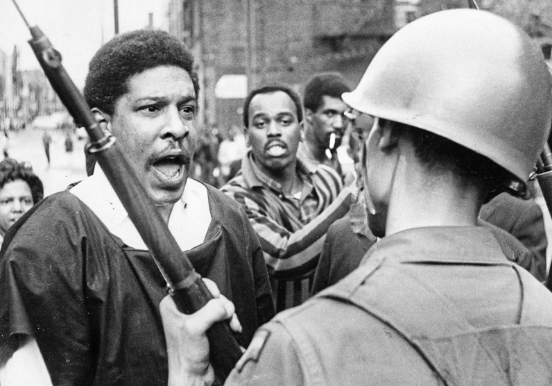 """Drop that gun and get out here,"" a man named ""Brother Phil"" shouts at National Guardsman Carl Fox during the riots that seared Pittsburgh, Sunday, April 7, 1968. Fox was son of Alma Speed Fox, then executive director of the Pittsburgh chapter of the NAACP. (Donald J. Stetzer/The Pittsburgh Press)"
