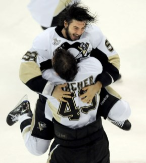 Defenseman Kris Letang jumps into the arms of teammate Philippe Boucher after defeating Detroit in Game 7 of the Stanley Cup, June 12, 2009. (Matt Freed/Post-Gazette)