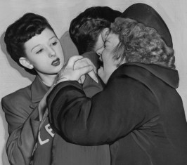 """""""My Boy, My Boy!"""" sobs Mrs. Barbara Nash as she embraces her 21-year-old son Lewis. At left is Nash girlfriend Ruth Schmidt. (Post-Gazette Archive)"""