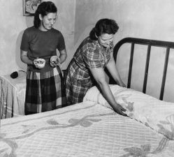Mary Gagich and Ethel Lerby in the bedroom used by the escapees. (Post-Gazette archive)