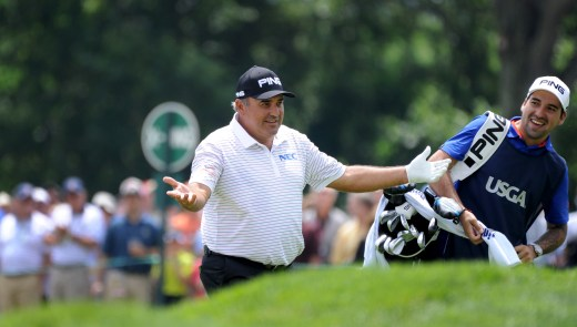 Angel Cabrera welcomes cheers from spectators after hitting a birdie on the 11th hole Friday at Oakmont. (Lake Fong/Post-Gazette)