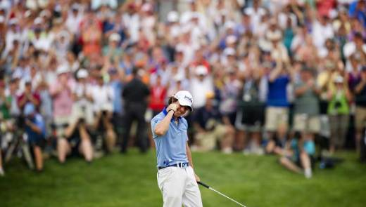 Rory McIlroy celebrates after sinking his final putt to win the 2011 U.S. Open at Congressional only two months after his collapse in the final round of the Masters. (Jim Watson/AFP/Getty Images)