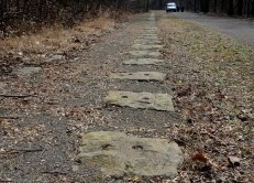 Two sets of tracks were alined on the stones of the 120 ft. wide trail of the Allegheny Portage Railroad. They led west to the Nations' First Railroad Tunnel, and last Engine House , then four miles to Johnstown where they would tranfer to the canals on the way to Pittsburgh. The Allegheny Portage Railroad was the first railroad to cross the Allegheny Mountains. The Portage Railroad was 36 miles long. (Darrell Sapp/Post-Gazette)